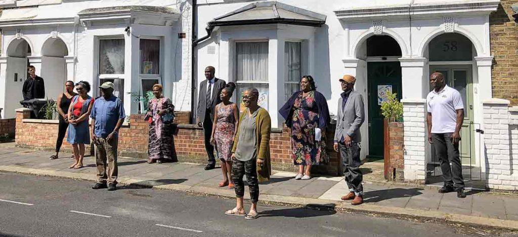 people singing in street