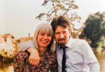 man and woman smiling at camera