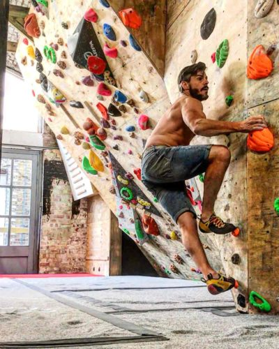 man on interior climbing wall