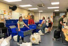 volunteers loading crates