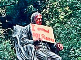 statue with paint and poster