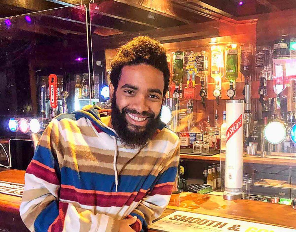 smiling man at bar
