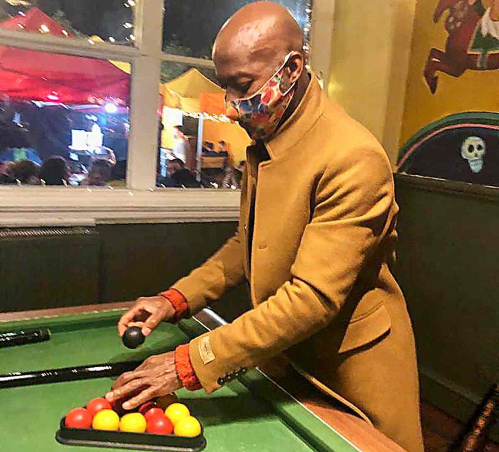 man  racking up pool balls