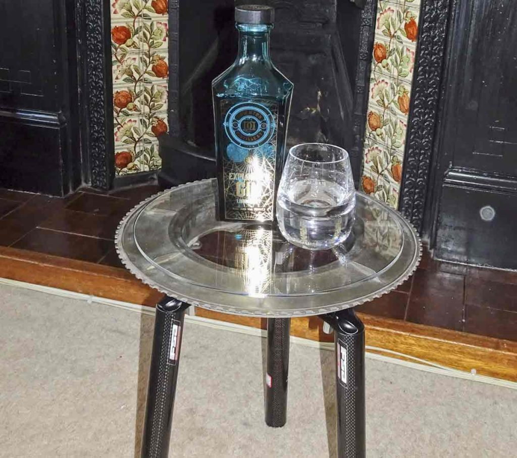 bottle and glass on metal table