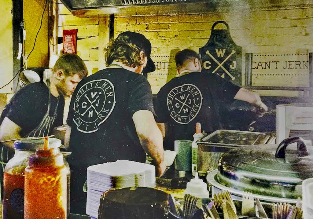 men cooking at indoor barbecue