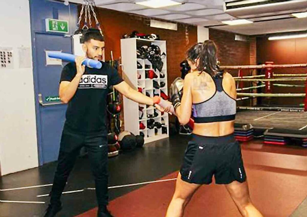 woman boxer training in gym
