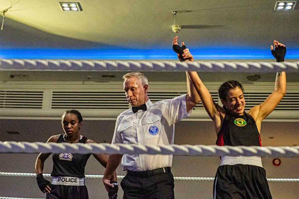 boxing ref lifts winner's arm