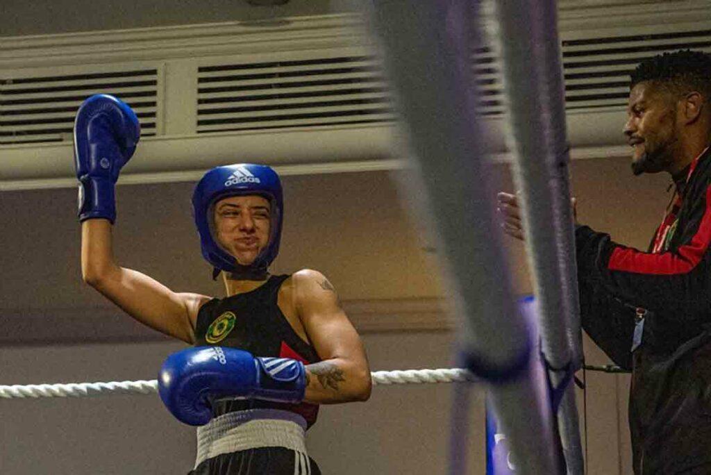 woman celebrates boxer in ring