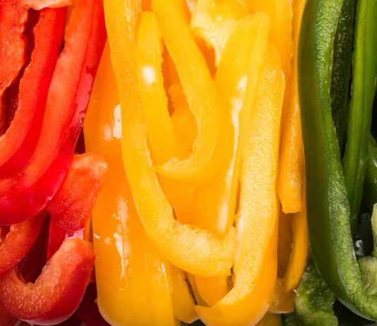 red yellow green peppers sliced