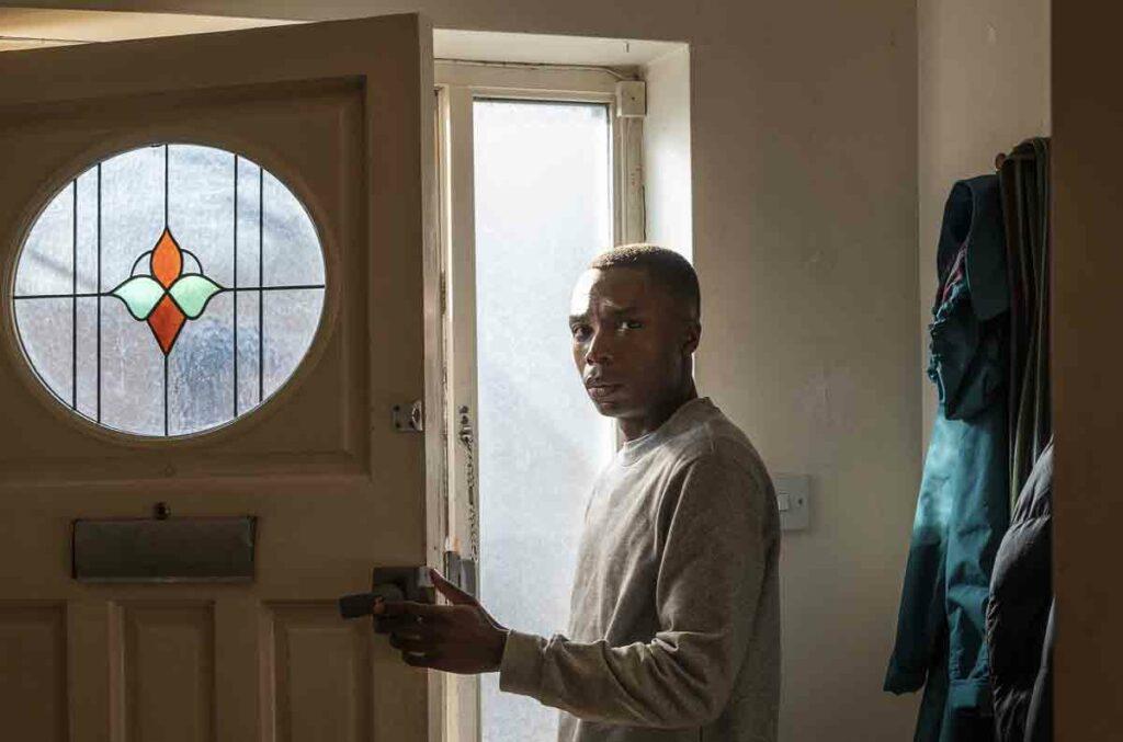 man at open door