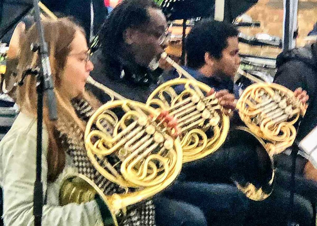 French horn players open air