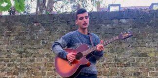 man with guitar in garden