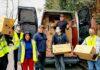 people unloading van