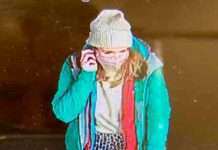 CCTV image of woman on mobile phone