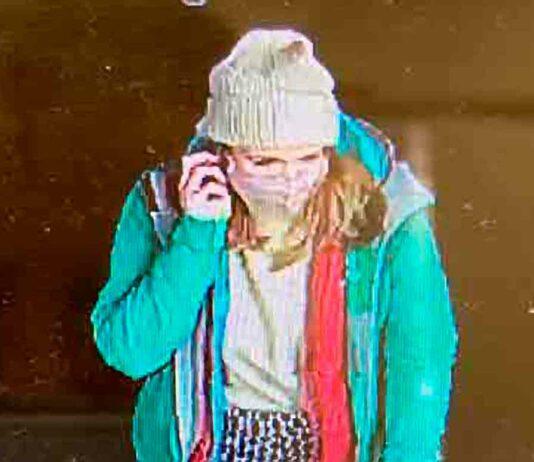 CCTV image of woman on mobile phone