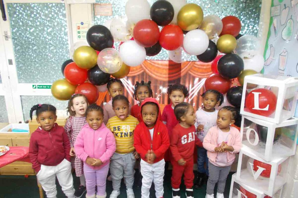 children in nursery with balloons