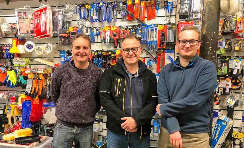 men in hardware shop