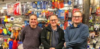 men in hardware shop