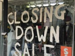 closing down sign in shop window