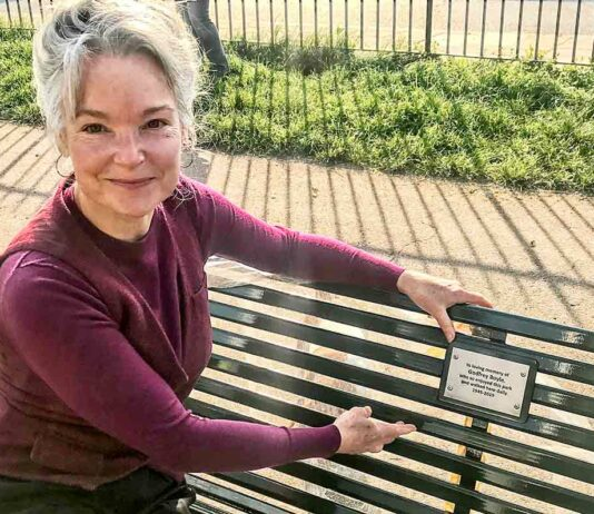 woman on park bench with plaque