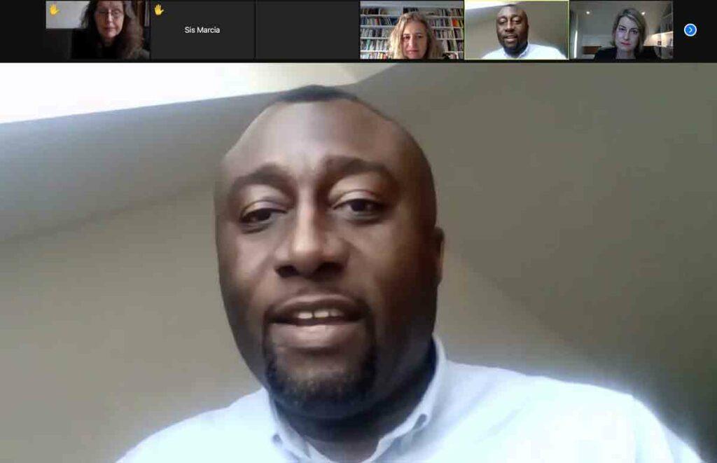 man speaking at online meeting