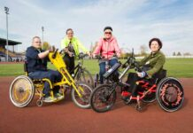 four people with disability cycles