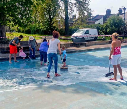 volunteers clean paddling pool