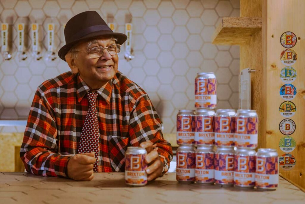 man with beer cans