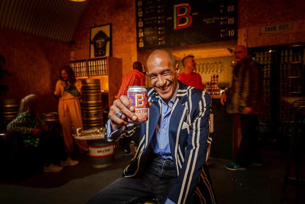 man with can of beer