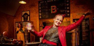 older woman in dark bar
