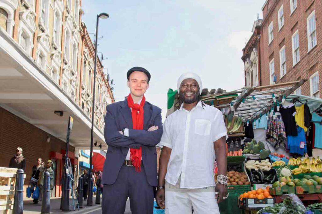 two men in front of street market