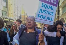 woman at protest with placard