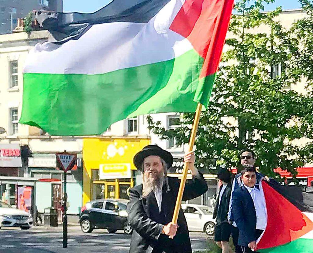 man waving Palestine flag