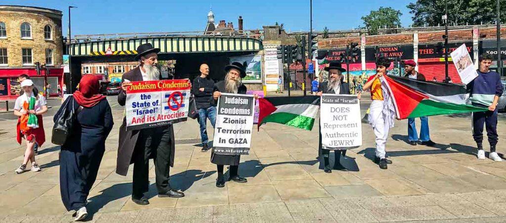 men in Jewish clothing with placards