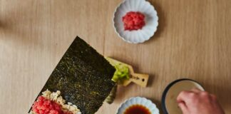 hand rolling sushi