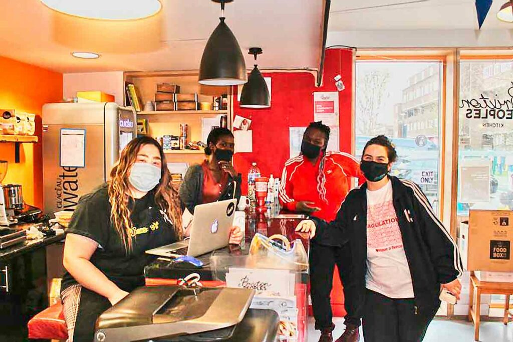women with Covid masks at counter