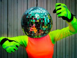 person with disco ball as head