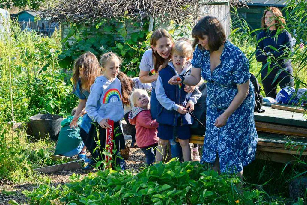 women and children in garden