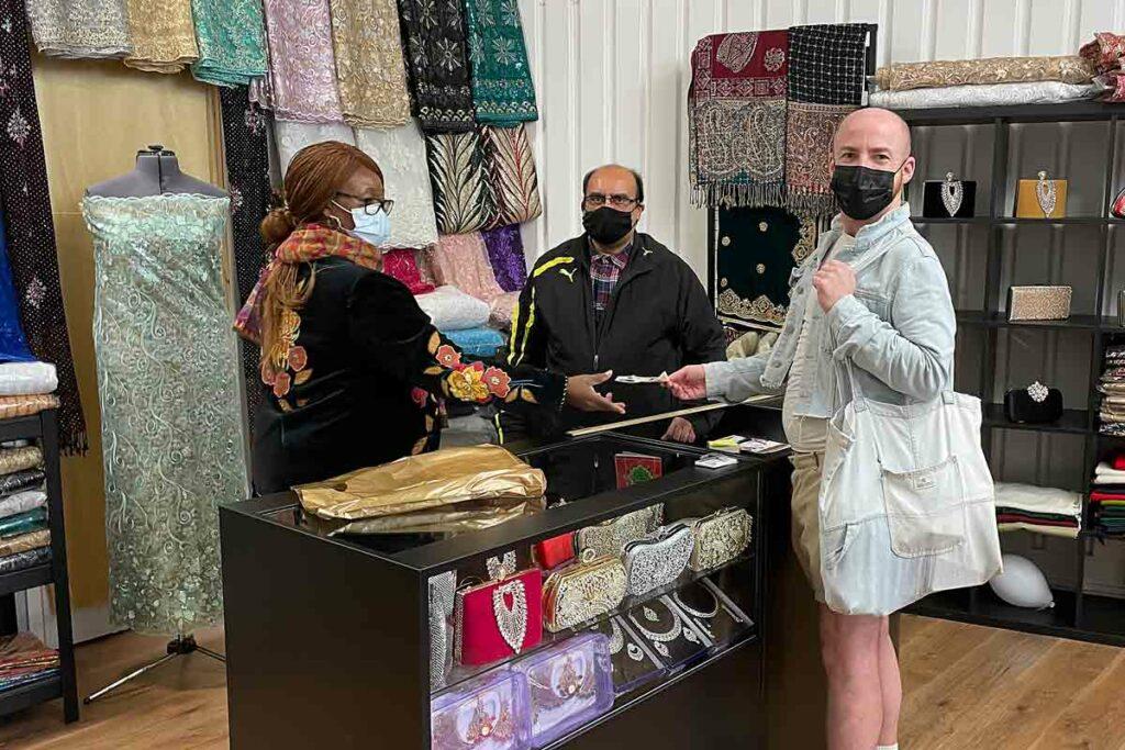 man buying cloth in shop