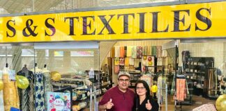 two shop owners outside new premises