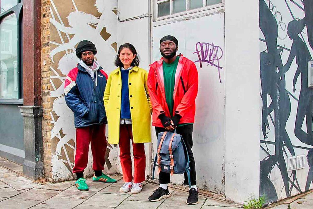 three people in urban setting