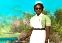 nurse in uniform poses for photograph