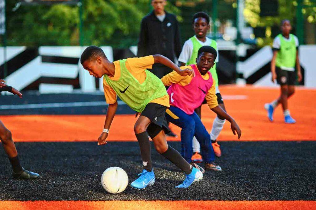 young men play football
