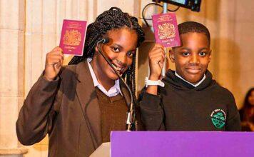 children holding UK passports