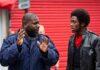 two men talking in street
