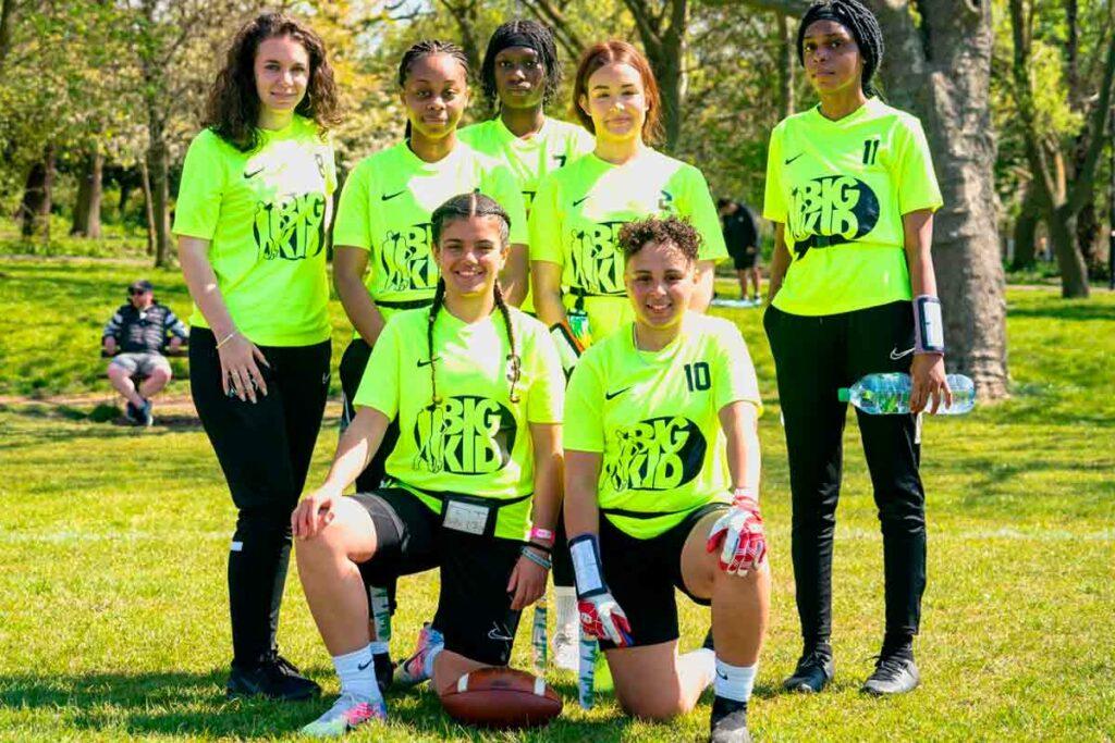 girls sport team poses for photo