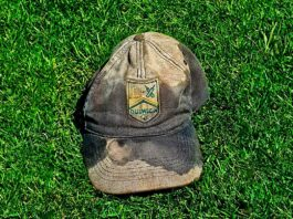 old cricket cap on grass