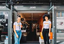 Two women in front of shop