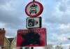 vandalised road sign