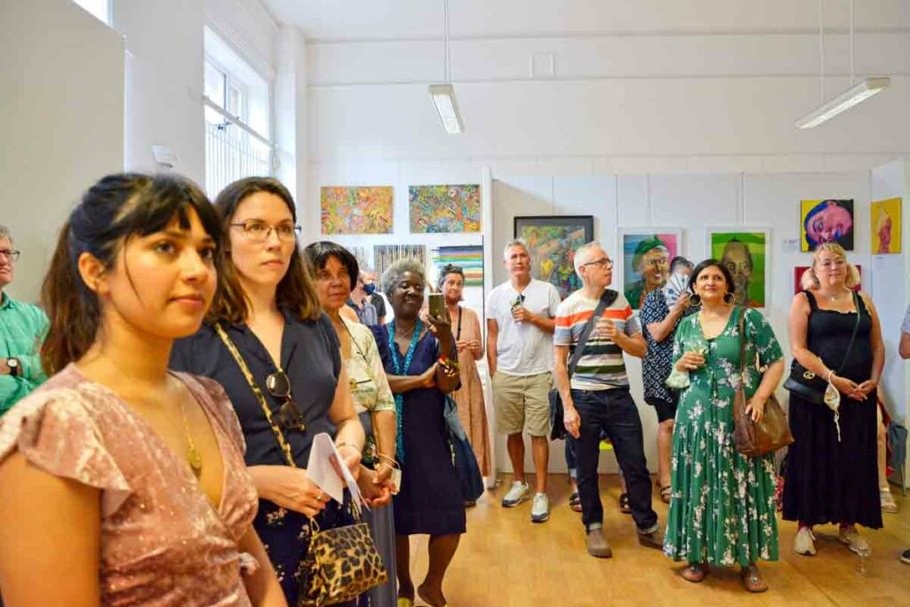 audience ;listen at art show awards ceremony